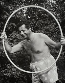 Comedian and television actor morey amsterdam posing with hula hoop picture id524974406?s=170x170