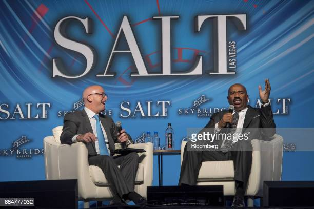 Comedian and television host Steve Harvey right speaks during a Bloomberg Television interview at the Skybridge Alternatives conference in Las Vegas...