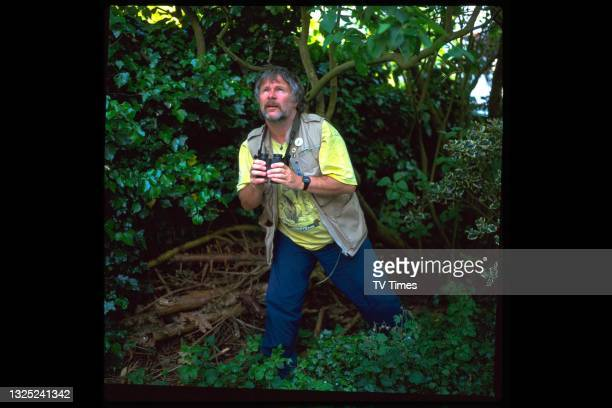 Comedian and television presenter Bill Oddie photographed outdoors with a pair of binoculars while promoting his natural history series Bird In The...