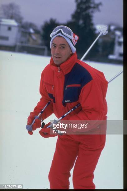 Comedian and television presenter Michael Barrymore photographed skiing, circa 1987.