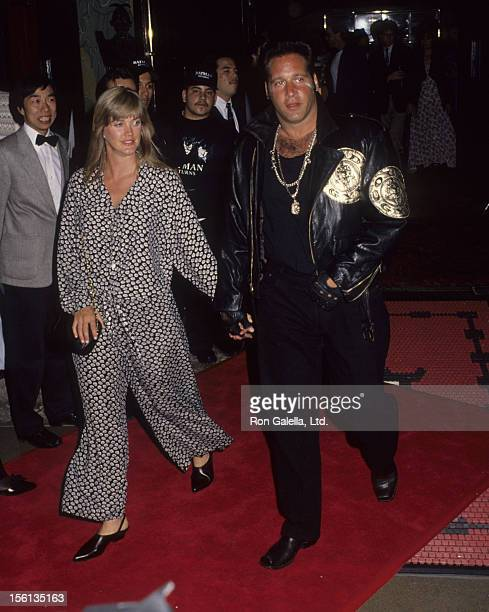 Comedian Andrew Dice Clay and date attending the premiere of 'Batman Returns' on June 16 1992 at Mann Chinese Theater in Hollywood California
