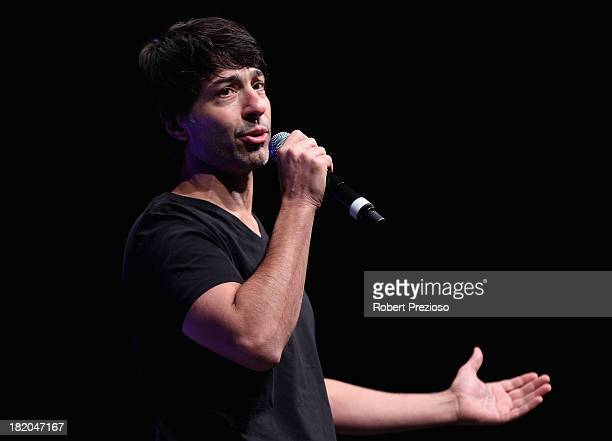 US comedian Arj Barker performs during the 2013 Blackwoods North Melbourne Grand Final Breakfast at Etihad Stadium on September 28 2013 in Melbourne...