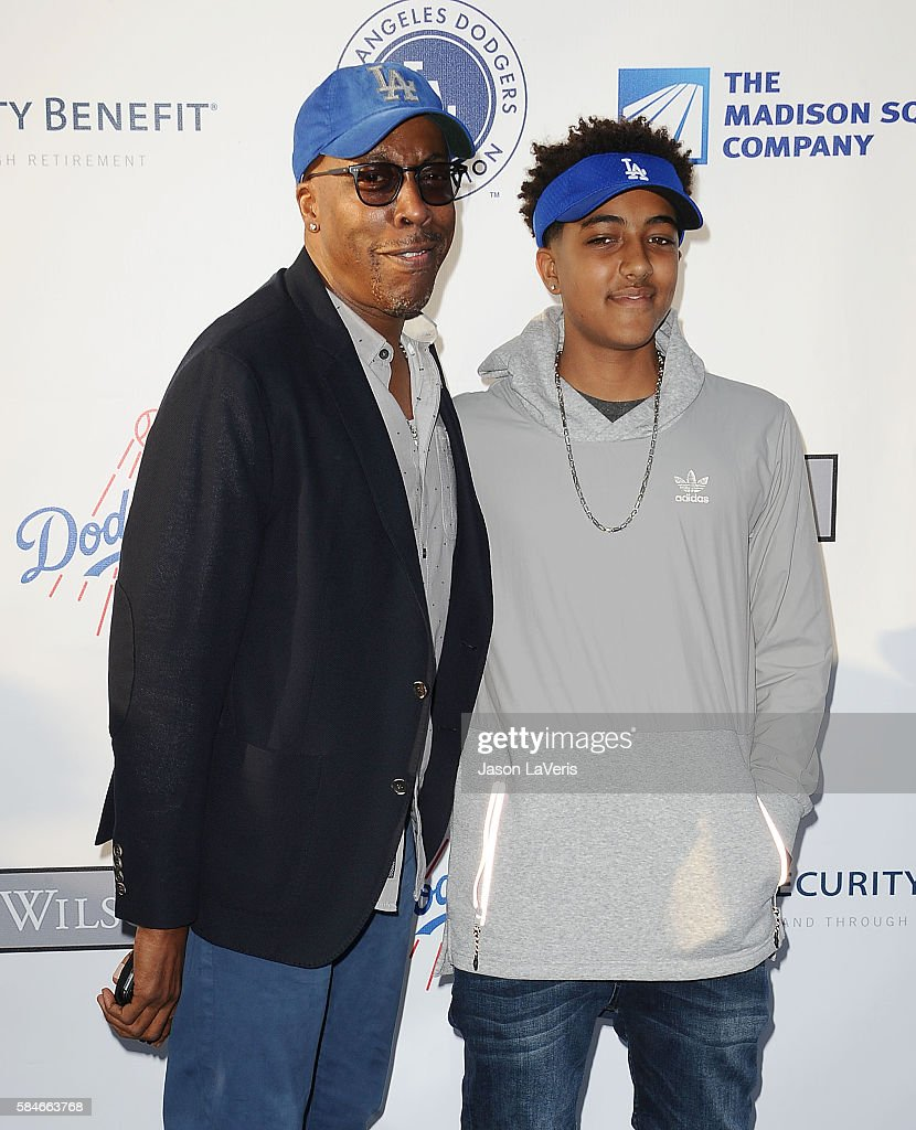 Comedian Arsenio Hall and son Arsenio Hall Jr. attend the Los Angeles Dodgers Foundation Blue Diamond gala at Dodger Stadium on July 28, 2016 in Los Angeles, California.