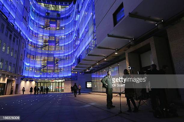 Comedian Arthur Smith is interviewed outside the BBC headquarters at New Broadcasting House which is illuminated at night on November 13 2012 in...