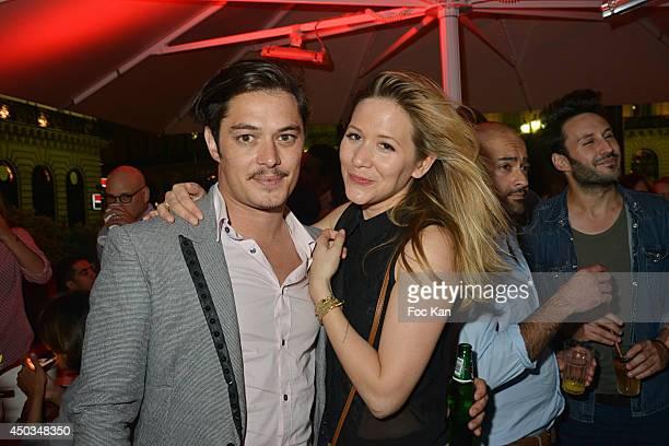Comedian Aurelien Wiik and TV presenter Stephanie Loire attend 'La Boumette' Party at L'Opera Restaurant on June 7 2014 in Paris France