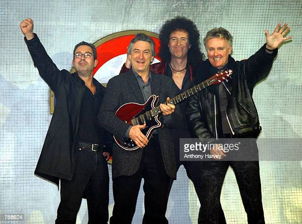 Comedian Ben Elton actor Robert de Niro Brian May and Roger Taylor pose for photographers March 26 2002 during a press conference to promote 'We will...