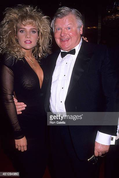 Comedian Benny Hill and Penthouse Pet attend the 17th Annual International Emmy Awards on November 20 1989 at the Sheraton Centre Hotel in New York...