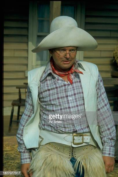 Comedian Benny Hill dressed as a cowboy, circa 1975.