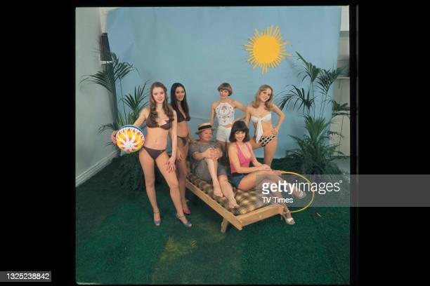 Comedian Benny Hill on set with the Hill's Angels song and dance troupe, circa 1977.