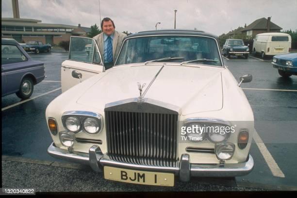 Comedian Bernard Manning getting into his Rolls Royce, circa 1974.