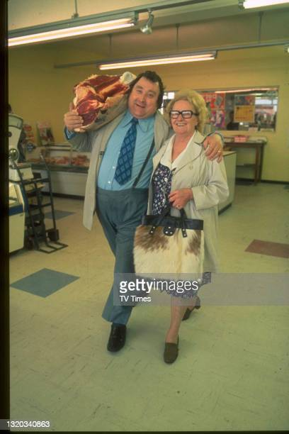 Comedian Bernard Manning photographed in a supermarket with his mother, circa 1974.