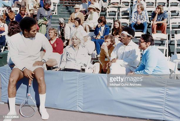 Comedian Bill Cosby chats with OJ Simpson at his celebrity tennis tournament on April 14 1973 in Los Angeles California