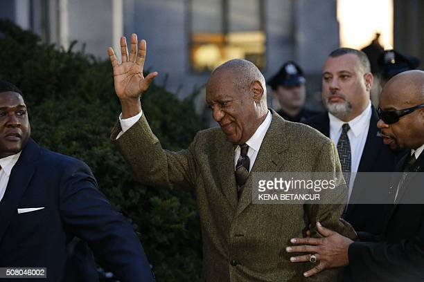 Comedian Bill Cosby waves as he leaves the Montgomery County courthouse in Norristown, Pennsylvania on February 2 , 2016. Cosby was in the Montgomery...