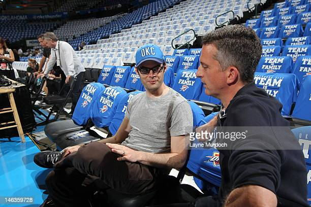 SNL comedian Bill Hader talks with sports columnist author and podcaster Bill Simmons prior to the game between the Miami Heat and the Oklahoma City...