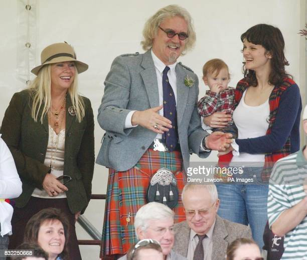 Comedian Billy Connolly attends the Lonach Highland Games in Aberdeenshire with wife Pamela Stephenson and daughter Cara and grandchild .