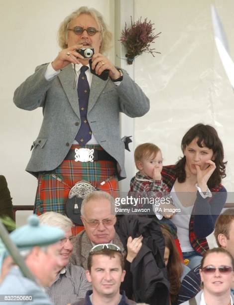 Comedian Billy Connolly attends the Lonach Highland Games in Aberdeenshire with his daughter Cara and grandchild.