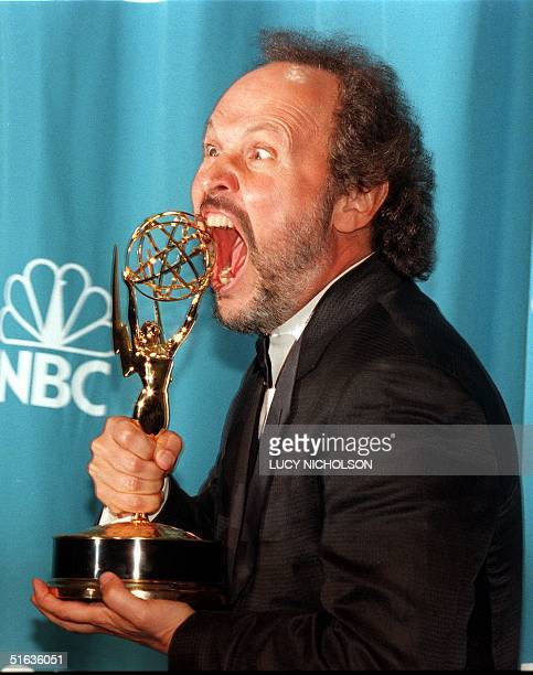 Comedian Billy Crystal bites his Emmy Award at the 50th Annual Primetime Emmy Awards 13 September at the Shrine Auditorium in Los Angeles Crystal won...