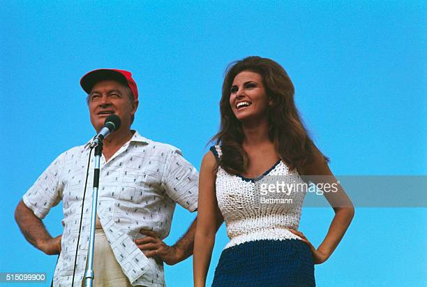 Comedian Bob Hope and actress Raquel Welch enertain troops at an unidentified outdoor site in Vietnam