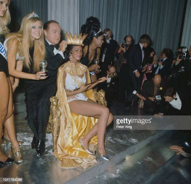 Comedian Bob Hope crowns Jennifer Hosten as the winner of the Miss World 1970 beauty pageant at the Royal Albert Hall in London, 20th November 1970....