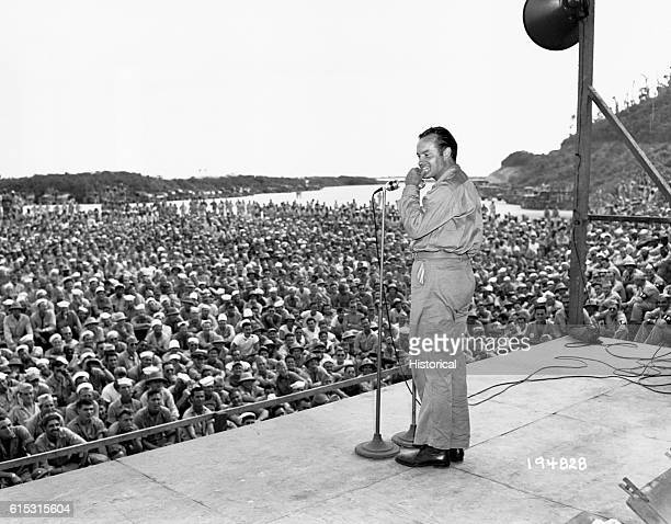 Comedian Bob Hope entertains a crowd of soldiers stationed in the South Pacific during World War II 1944