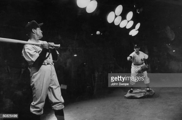 Comedian Bob Hope in baseball uniform acting part of final Dodger batter as Don Larsen reenacts his hit series game on TV