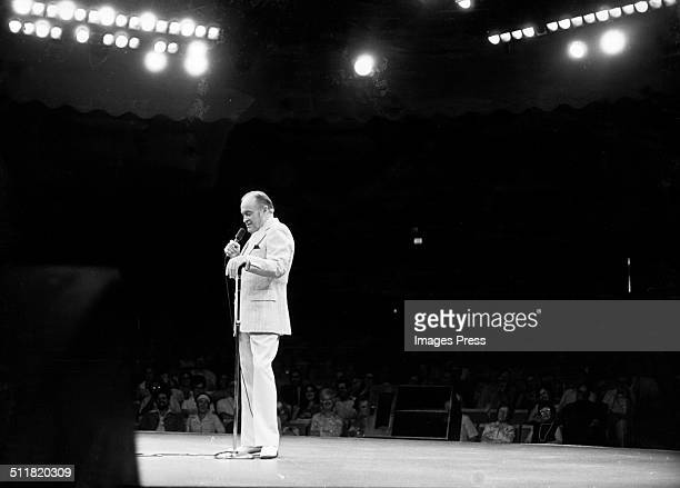 Comedian Bob Hope performs on stage in Gaithersburg, Maryland, circa 1976.