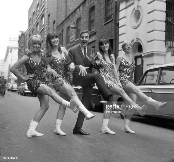 Comedian Bob Monkhouse joins The Beat Girls in a dance routine in Floral Street London The girls are in a show business party headed by Bob Monkhouse...