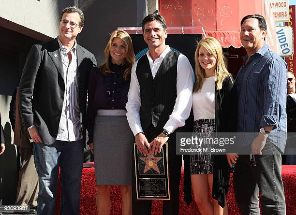 Comedian Bob Saget producer Lori Laughlin actor John Stamos actress Candice Bure and Jeff Franklin pose during induction ceremony on the Hollywood...