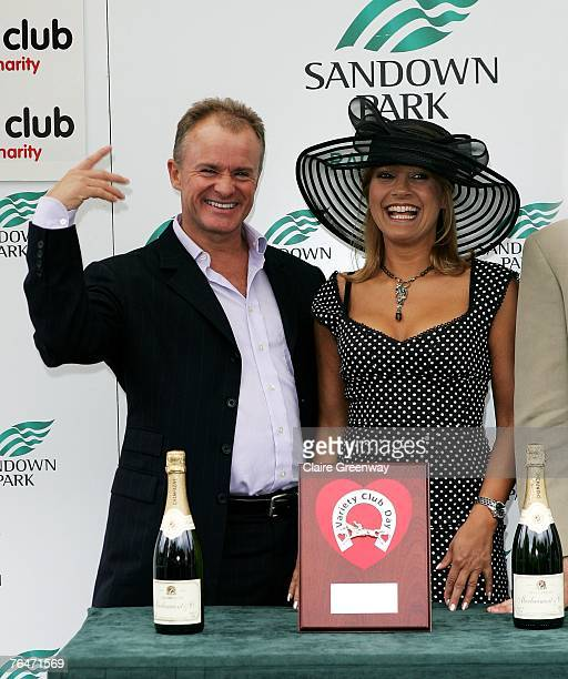 Comedian Bobby Davro and actress Malandra Burrows present the trophy for the first race of the day at the 49th Variety Club Race Day at Sandown race...