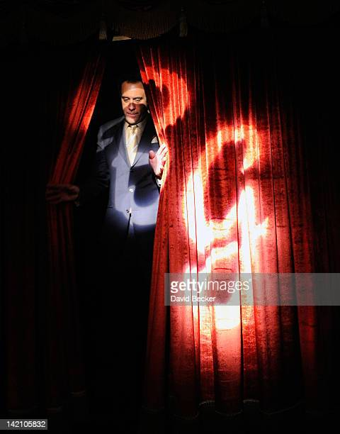 Comedian Brad Garrett walks on stage through the curtains with his initials illuminated on them during the grand opening celebration of his new...