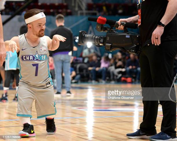 Comedian Brad Williams plays to the camera during the NBA AllStar Celebrity Game at Bojangles' Coliseum in Charlotte NC on Friday Feb 15 2019