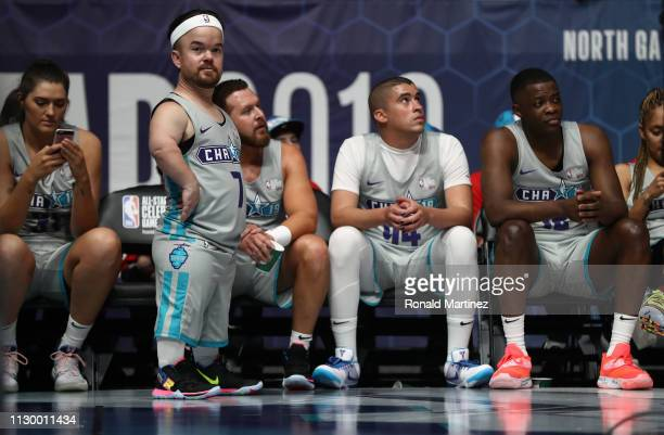 Comedian Brad Williams stands next to the bench during the 2019 NBA AllStar Celebrity Game at Bojangles Coliseum on February 15 2019 in Charlotte...