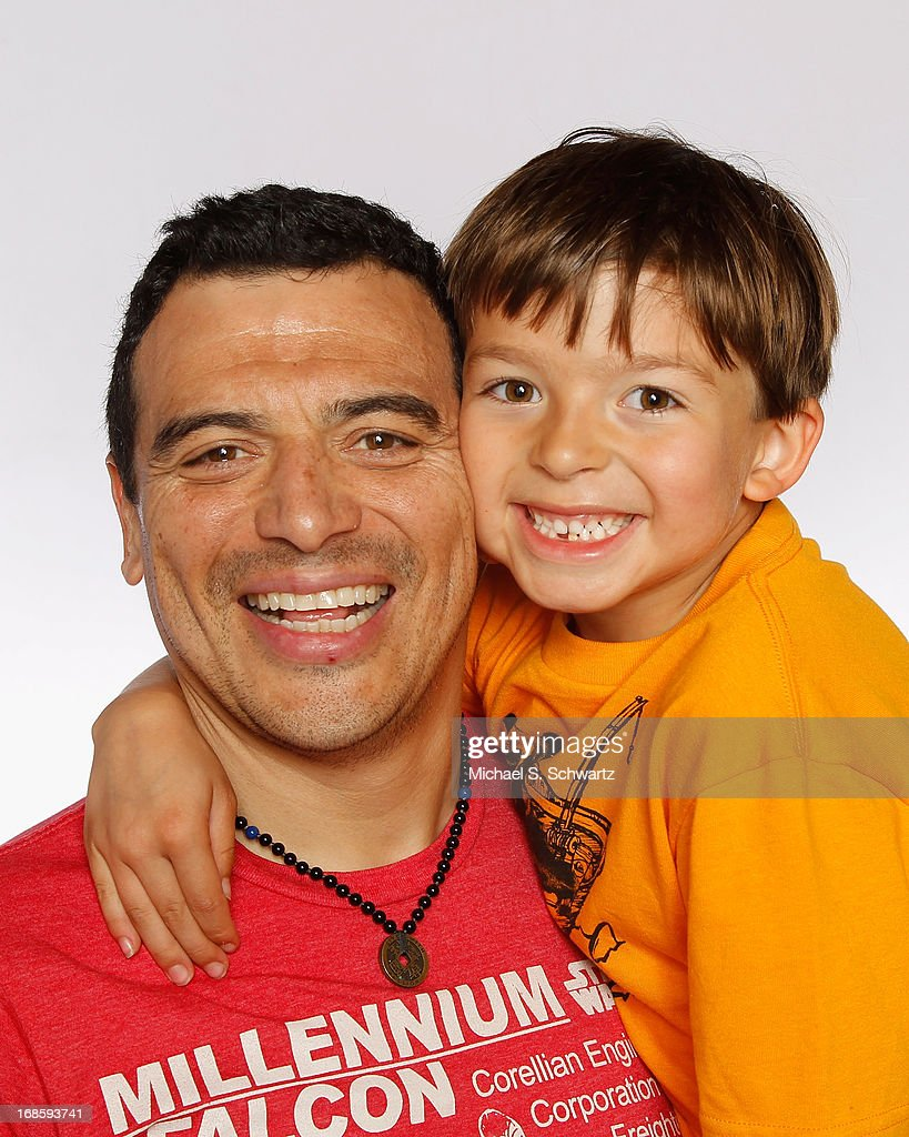 Comedian Carlos Mencia (L) and Lucas Mencia pose during their attendance at The Ice House Comedy Club on May 11, 2013 in Pasadena, California.