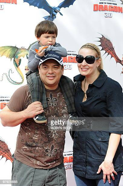 """Comedian Carlos Mencia arrives with son Lucas and wife Amy Mencia for the premiere of DreamWorks' """"How To Train Your Dragon"""" at the Gibson..."""