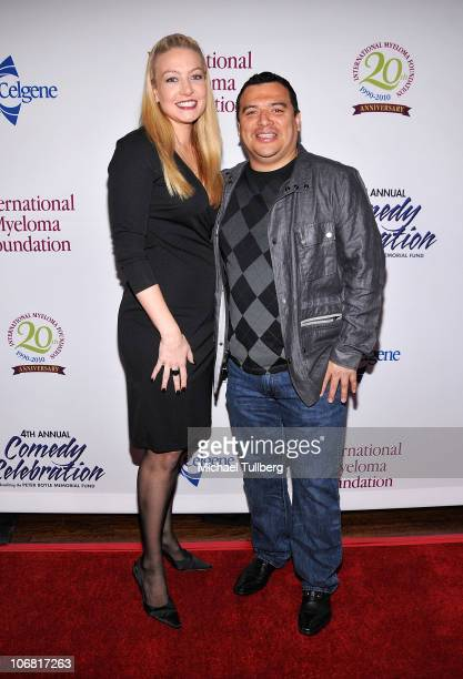 Comedian Carlos Mencia arrives with wife Amy at the International Myeloma Foundation's 4th Annual Comedy Celebration on November 13 2010 in Los...