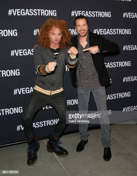 Comedian Carrot Top jokes around with NASCAR driver Kurt Busch during the Vegas Strong Benefit Concert at TMobile Arena to support victims of the...