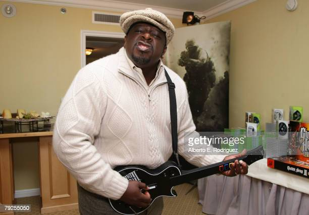 Comedian Cedric the Entertainer is seen playing Guitar Hero III: Legends of Rock at The Luxury Lounge in honor of the 2008 SAG Awards featuring...