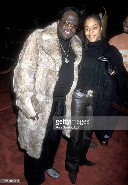 Comedian Cedric 'The Entertainer' Kyles and wife Lorna Wells attend the 'Ali' Hollywood Premiere on December 12 2001 at Grauman's Chinese Theatre in...