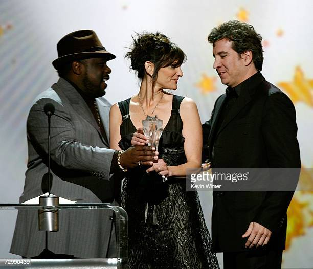 Comedian Cedric the Entertainer presents the 'Best Song' award to songwriters Anne Preven and Scott Cutler onstage during the 12th Annual Critics'...
