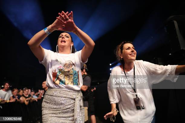 Comedian Celeste Barber and singer Tina Arena dance in the crowd during Fire Fight Australia at ANZ Stadium on February 16 2020 in Sydney Australia