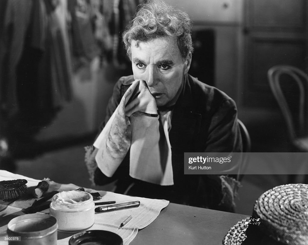 Comedian Charlie Chaplin (1889-1977) removes his clown make-up in a scene from the United Artists film 'Limelight', which he also wrote, directed and produced. Original Publication: Picture Post - 6099 - Chaplin D.P. - pub. 1952