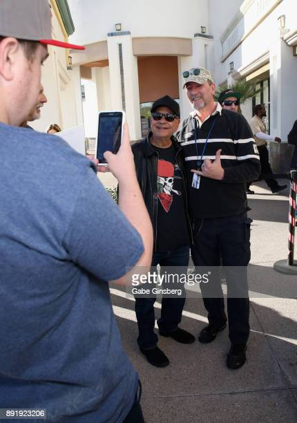 Comedian Cheech Marin poses with a fan during a meet and greet to introduce his new line of cannabis products at Essence Vegas Cannabis Dispensary on...