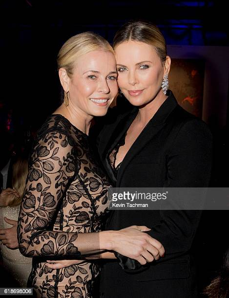 Comedian Chelsea Handler and honoree Charlize Theron attends amfAR's Inspiration Gala at Milk Studios on October 27 2016 in Hollywood California