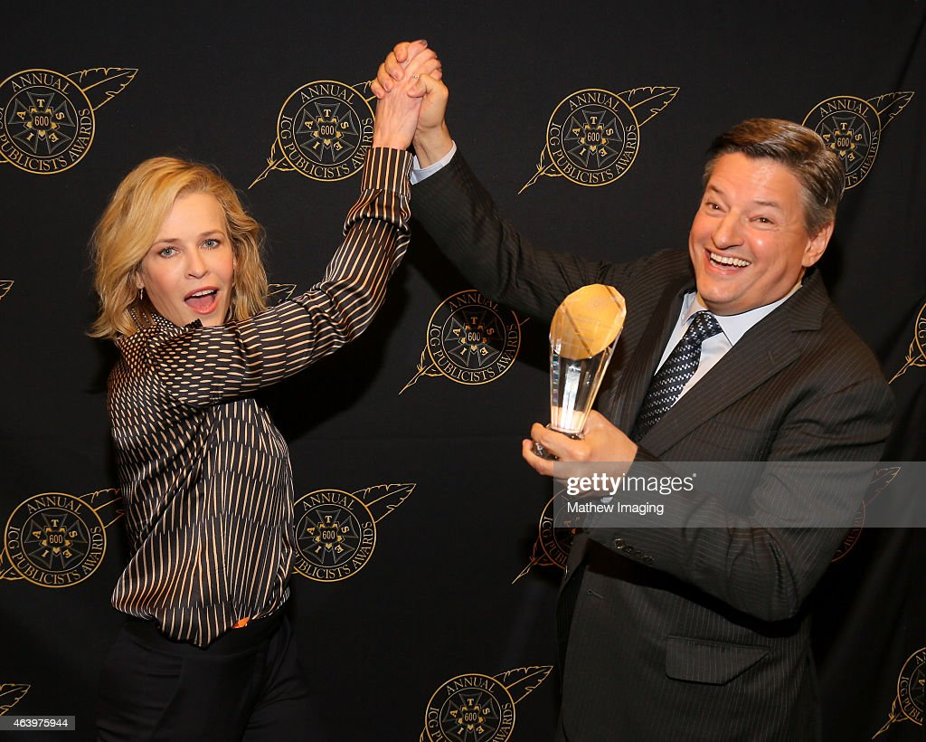 Comedian Chelsea Handler (L) and Netflix, Chief Content Officer Ted Sarandos pose with the Television Showmanship Award backstage at the 52nd Annual ICG Publicists Awards at The Beverly Hilton Hotel on February 20, 2015 in Beverly Hills, California.