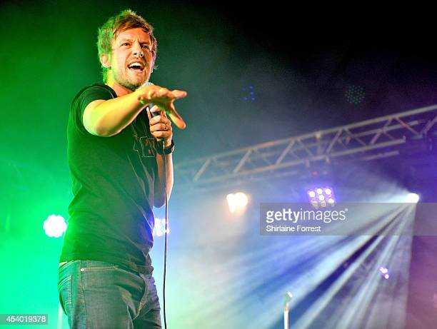 Comedian Chris Ramsey performs on Day 2 of the Leeds Festival at Bramham Park on August 23 2014 in Leeds England