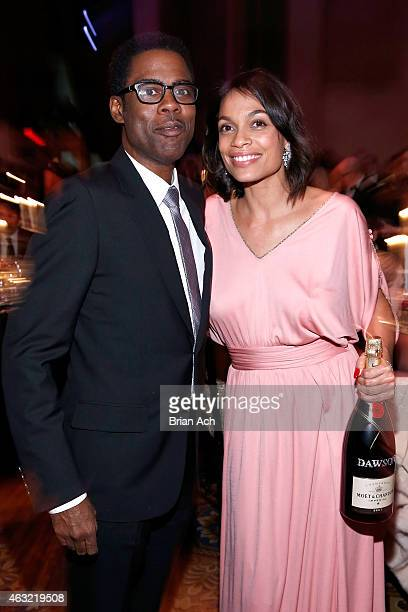 Comedian Chris Rock and actress Rosario Dawson attend the Moet Chandon toast to the amfAR Gala at Cipriani Wall Street on February 11 2015 in New...