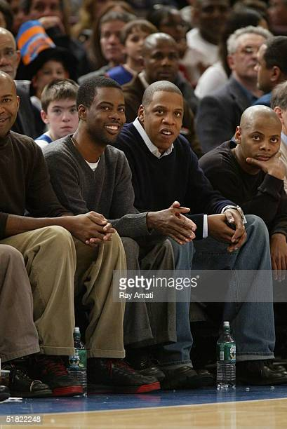 Comedian Chris Rock and rapper JayZ and friend Tyran Ty Ty Smith sit courtside at the New York Knicks versus Orlando Magic game at Madison Square...