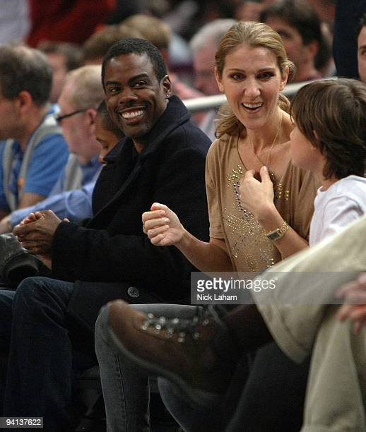 Comedian Chris Rock and singer Celine Dion watch the game between the New York Knicks and the Portland Trail Blazers at Madison Square Garden on...