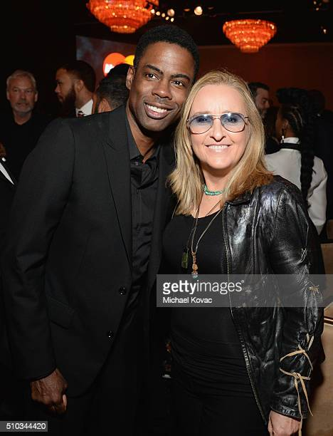 Comedian Chris Rock and singer Melissa Etheridge attend the 2016 PreGRAMMY Gala and Salute to Industry Icons honoring Irving Azoff at The Beverly...