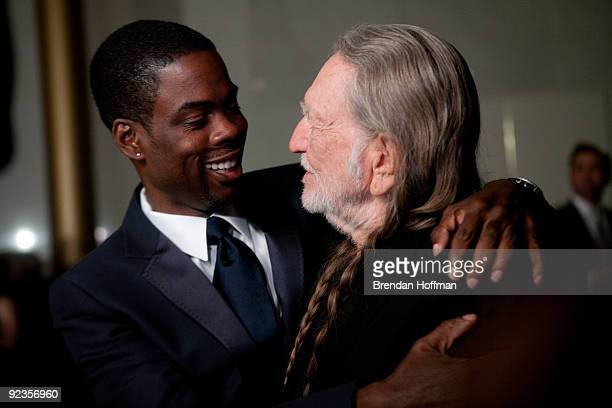 Comedian Chris Rock hugs singer Willie Nelson at the 12th annual Mark Twain Prize for American Humor at the John F Kennedy Center on October 26 2009...